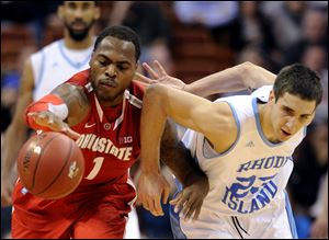 Ohio State's Deshaun Thomas, left, and Rhode Island's Nikola Malesevic fight for the loose ball.