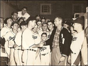 The 1948 Zanesville Dodgers celebrate their Ohio-Indiana League championship with batboy George Eistetter, center. Richard Meyers is the third player from the right, behind the head and left shoulder of the man in the jacket.