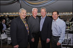Attending the ProMedica Hospice and Dementia Care were from left, Promedica's wine event honorary chairman Russ Ebeid, VIP guest and pro hockey Hockey Hall of Fame member Gordie Howe, Randy Oostra, ProMedica CEO, and Dr. Murray Howe, son of Gordie Howe.