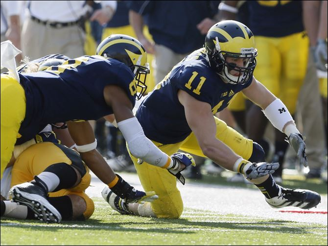 SPT UMfb17-1 Michigan safety Jordan Kovacs chases a fumble against Iowa during the first quarter Saturday at Michigan Stadium in Ann Arbor. The Wolverines can still win their division, but they do need help: Nebraska would also need to lose.