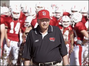 St. John's University football coach John Gagliardi leads his team onto the field at Collegville, Minn., in October, 2003.