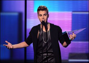 Justin Bieber accepts the award for favorite male artist in pop/rock at the 40th Annual American Music Awards on Sunday in Los Angeles.