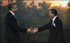 President Obama is greeted by Cambodia's Prime Minister Hun Sen in Phnom Penh, Cambodia, Monday.