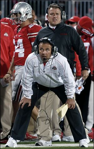 Slug: SPT osufb8p  The Blade/Jeremy Wadsworth  Caption: Ohio State head coach Urban Meyer watches the action against  Nebraska Saturday, 10/06/12, in Columbus, Ohio.