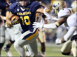 Toledo running back David Pasquale runs the ball.