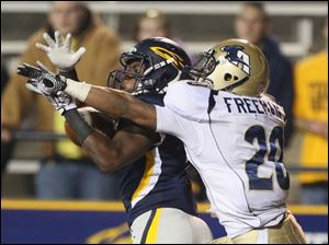 Akron's Malachi Freeman breaks up a pass intended for Toledo receiver Bernard Reedy.