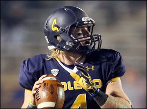 Toledo quarterback Austin Dantin looks to throw against Akron.