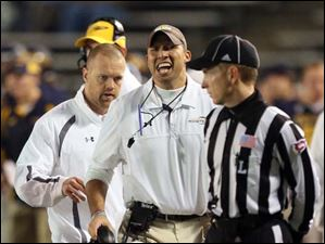 Toledo head coach Matt Campbell argues a call.