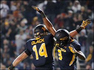 Toledo's Alonzo Russell celebrates his touchdown score with Justin Olack.