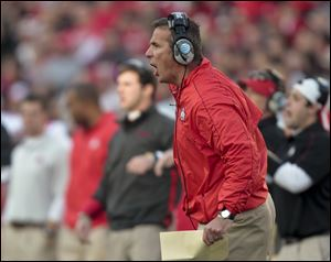 OSU coach Urban Meyer kept all 21 seniors together and, now, the 11-0 Buckeyes are on the verge of an undefeated season.