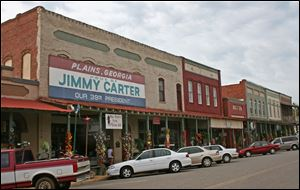 Storefronts along the main commercial street in Plains announce that the town is the home of Jimmy Carter.