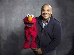 'Sesame Street' muppet Elmo and his former puppeteer Kevin Clash.