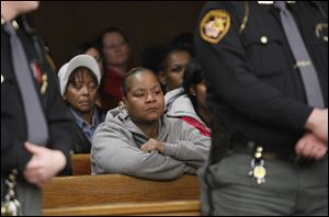 Markeda Holcomb-Brownlee, mother of murder victim CreJonnia Bell, listens during proceedings for Traquawn Gibson in Toledo Municipal Court. He went before a judge Tuesday.
