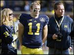 Michigan safety Jordan Kovacs (11) with his parents Louis and Susan Kovacs on Senior Day in 2012.