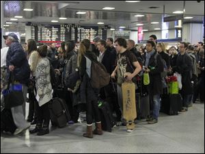 Passengers wait to board a train in New York's Penn Station, Wednesday. Around 43.6 million Americans were expected to journey 50 miles or more between Wednesday and Sunday, just a 0.7 percent increase from last year, according to AAA's yearly Thanksgiving travel analysis.