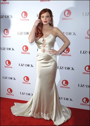 "Actress Lindsay Lohan attends a dinner celebrating the premiere of ""Liz & Dick"" at the Beverly Hills Hotel on Tuesday."