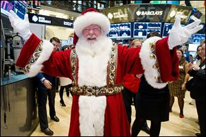 Santa Claus visits the trading floor of the New York Stock Exchange this morning before he participated in opening bell ceremonies featuring the Macy's Thanksgiving Day Parade.