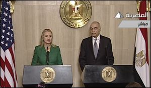 In this image made from Egyptian State Television, Secretary of State Hillary Clinton, left, and Egyptian Foreign Minister Mohammed Kamel Amr, right, give a joint news conference announcing a cease-fire between Israel and Hamas in Cairo.