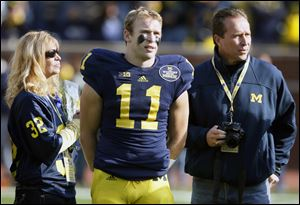 Michigan safety Jordan Kovacs with his parents, Susan and Louis,  is a Clay graduate. He ranks 13th on the career tackles list at UM.