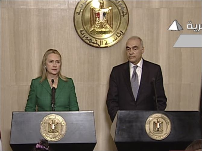 Mideast Egypt Israel Palestinians In this image made from Egyptian State Television, Secretary of State Hillary Clinton, left, and Egyptian Foreign Minister Mohammed Kamel Amr, right, give a joint news conference announcing a cease-fire between Israel and Hamas in Cairo.