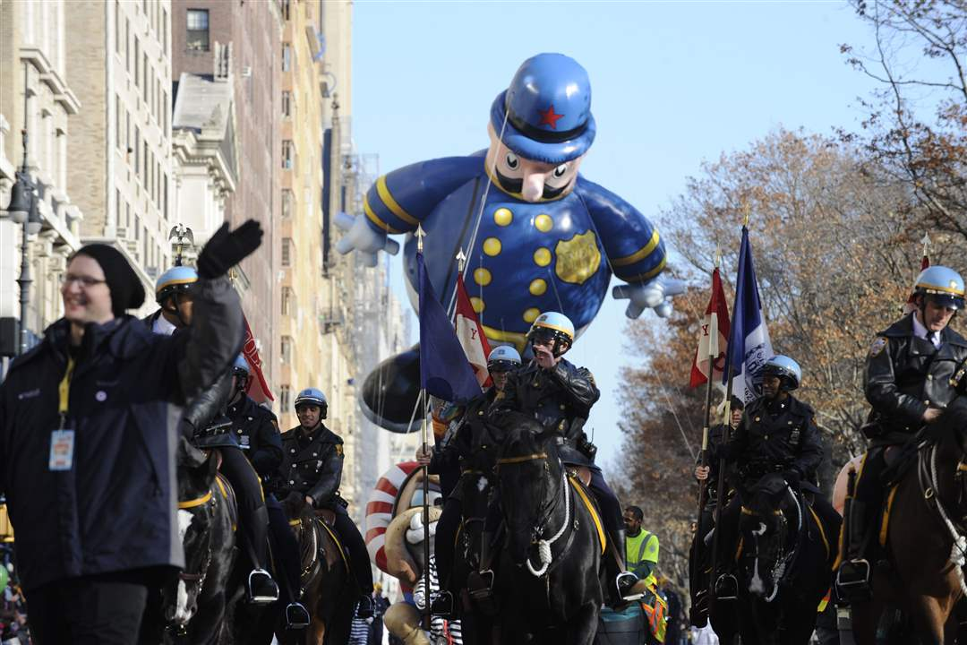 Mounted-police-lead-a-policeman-balloon-1