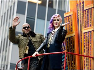Flo Rida and Stayc Reigns ride a float in the Macy's Thanksgiving Day Parade in New York.