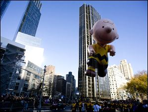 The Charlie Brown balloon floats in the Macy's Thanksgiving Day Parade in New York.