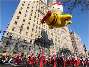 The Hello Kitty Balloon makes it's way down New York's Central Park West in the 86th annual Macy's Thanksgiving Day Parade.