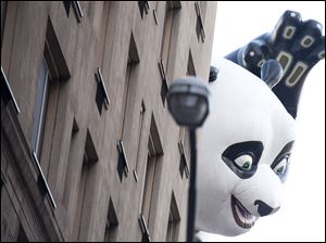 The Kung Fu Panda balloon floats in the Macy's Thanksgiving Day Parade in New York.