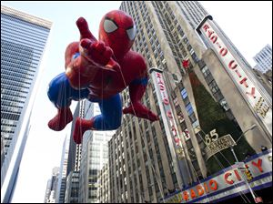 The Spider-Man balloon floats in the Macy's Thanksgiving Day Parade in New York in New York.