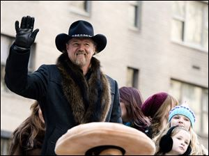 Trace Adkins rides a float in the Macy's Thanksgiving Day Parade in New York.