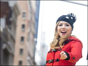 Jennette McCurdy rides a float in the Macy's Thanksgiving Day Parade in New York, Thursday.