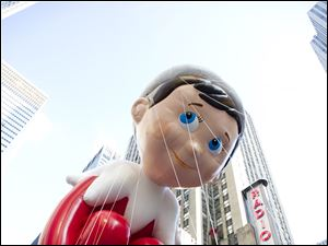 The Elf on the Shelf balloon floats in the Macy's Thanksgiving Day Parade in New York.