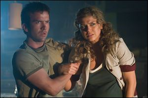 "Lucas Black (left) and Adrianne Palicki in Screen Gems' sci-fi action thriller, ""Legion."""
