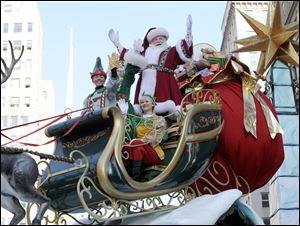 Santa Claus waves to the crowd at Herald Square during the 86th annual Macy's Thanksgiving Day Parade on Thursday.