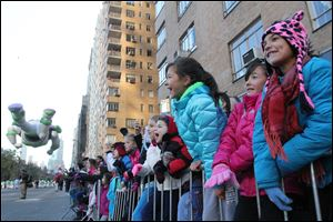 Spectators cheers during the 86th Annual Macy's Thanksgiving Day Parade on Thursday.