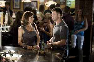 Adrianne Palicki, left, and Chris Hemsworth in a scene from