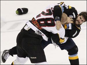 Toledo's defenseman Cody Lampl fights Cincinnati's forward Mattias Lindstrom.