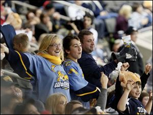 Walleye fans cheer during the second period of Friday night's home game against Cincinnati.