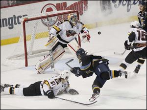 Toledo's center Joey Martin's (14) shot on goal is rebuffed by Cincinnati's goal tender Brian Foster.