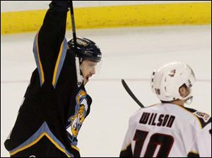Toledo's right wing forward Willie Coetzee (15) cheers after assisting his teammate defenseman Ben Youds to score.