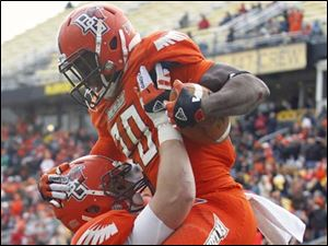 Bowling Green TB  John Pettigrew (20) celebrates scoring a touchdown against Buffalo with FB Tyler Beck (89).
