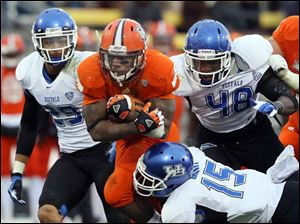 Bowling Green State University TB John Pettigrew (20) runs the ball against Buffalo FS Derek Brim (15).