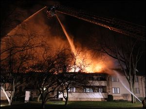 Firefighters work to put out flames at a condominium complex Thursday, on Byrnwyck West in Monclova Township.