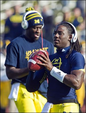 To date, Denard Robinson holds the NCAA single-season record for rushing yards by a quarterback (1,702 yards, set in 2010), and is third in the NCAA and holds the Big Ten all-time mark for career rushing yards by a quarterback (4,273 yards).