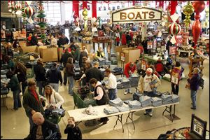 Shoppers investigate Black Friday deals at Bass Pro Shop.
