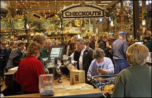 Shoppers wait to check out on Black Friday at Bass Pro Shops in Rossford. General manager Jarron Ritchie said about 700 people were waiting outside the outdoor megastore for the doors to open on Friday morning.