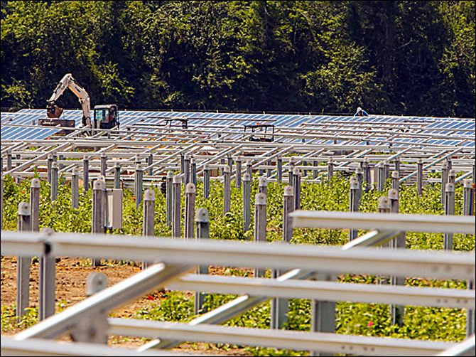 Workers install the structures which will hold solar panels Workers install the structures which will hold solar panels on a farm in St. Paul, N.C. Land owners in rural eastern North Carolina are leasing out there land to solar companies.
