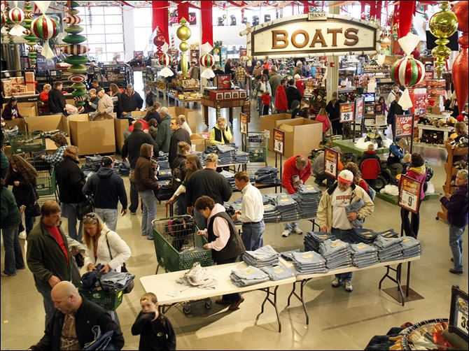 Shoppers make their way through Shoppers investigate Black Friday deals at Bass Pro Shop.