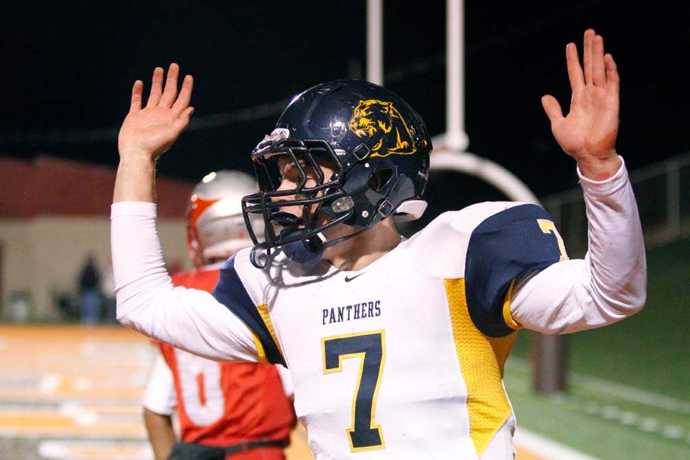 Whitmer-wins-semifinal-arms-up
